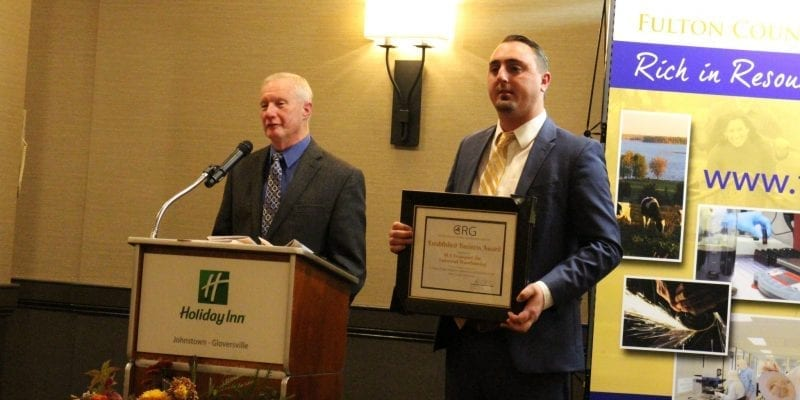 SLA Transport, Inc./Universal Warehousing, Inc. General Manager Andrew Olbrych, left, and Vice President Dave Groff are presented with the Large Established Business Award